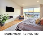 Stock photo beautiful master bedroom with view 128937782