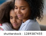 close up of young black mother... | Shutterstock . vector #1289387455