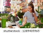 young florist taking order from ... | Shutterstock . vector #1289405965
