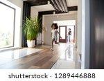 happy little black girl running ... | Shutterstock . vector #1289446888
