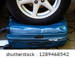 car wheel on the suitcase. the... | Shutterstock . vector #1289468542