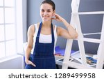 worker woman with drill... | Shutterstock . vector #1289499958