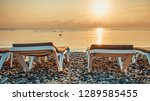 two empty deckchairs on the... | Shutterstock . vector #1289585455