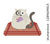 a kitten with a mouse in mouth... | Shutterstock .eps vector #1289609815