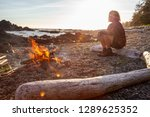 girl enjoying a camp fire on... | Shutterstock . vector #1289625352