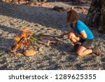 camp fire on the beach during a ... | Shutterstock . vector #1289625355