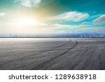 empty asphalt road and city... | Shutterstock . vector #1289638918
