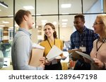 happy young colleagues with... | Shutterstock . vector #1289647198