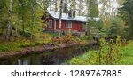 house next to the river in... | Shutterstock . vector #1289767885