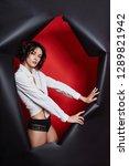 woman in underwear looking out...   Shutterstock . vector #1289821942
