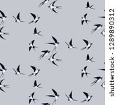 Stock vector seamless pattern of four colored swallow silhouettes on a light grey background flying birds in 1289890312