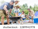 man preparing food in barbecue... | Shutterstock . vector #1289941978