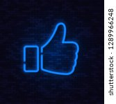neon blue thumb up   on brick... | Shutterstock .eps vector #1289966248