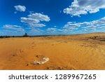 hot summer sandy desert under a ... | Shutterstock . vector #1289967265