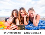 group of three cheerful happy... | Shutterstock . vector #1289985685