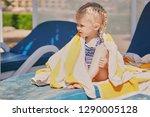 cute  little girl blonde at the ...   Shutterstock . vector #1290005128