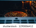 pizza baked in the oven. a view ... | Shutterstock . vector #1290006412