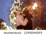 young cheerful couple kiss ... | Shutterstock . vector #1290044095
