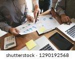 business executives negotiate... | Shutterstock . vector #1290192568