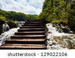 wet wooden stairs with... | Shutterstock . vector #129022106