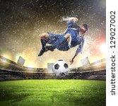 football player in blue shirt... | Shutterstock . vector #129027002