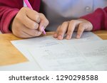 students using pen writing... | Shutterstock . vector #1290298588