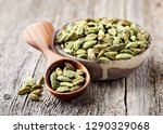 cardamom beans  on wooden board | Shutterstock . vector #1290329068