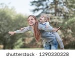 mom plays with her little son... | Shutterstock . vector #1290330328