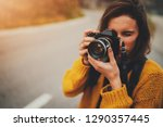 young female photographer... | Shutterstock . vector #1290357445