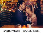 romantic couple dating in pub... | Shutterstock . vector #1290371338