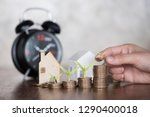 woman hand stacking dollars... | Shutterstock . vector #1290400018