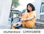 beauty asian woman with yellow... | Shutterstock . vector #1290418858