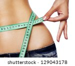 hand measuring waist   Shutterstock . vector #129043178