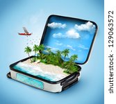 open suitcase with a tropical... | Shutterstock . vector #129063572