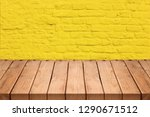 empty wooden table over yellow... | Shutterstock . vector #1290671512