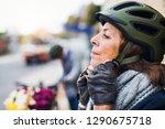 active senior woman standing... | Shutterstock . vector #1290675718