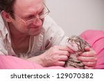 Old Man Pets A Scottish...