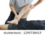 physical therapist treats knee...   Shutterstock . vector #1290738415