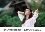 happy woman on the beach of... | Shutterstock . vector #1290741322