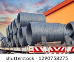 stacking of wire rod on truck... | Shutterstock . vector #1290758275