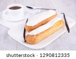 vanilla eclair and coffee cup | Shutterstock . vector #1290812335