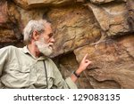 Old Man Points At The Ancient...