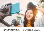 Asian woman making video with smartphone gimbal outdoor - Happy Asiatic girl having fun with new technology trends for social media - Millennials people, generation z, tech and youth lifestyle concept - stock photo
