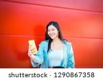 happy asian influencer using... | Shutterstock . vector #1290867358
