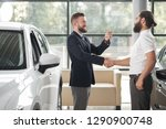 manager of car center shaking... | Shutterstock . vector #1290900748