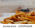 delicious hot fried potatoes | Shutterstock . vector #1290902608