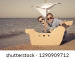 father and son playing on the... | Shutterstock . vector #1290909712