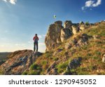 tourist on the rock. girl... | Shutterstock . vector #1290945052