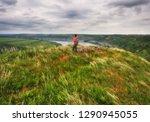 tourist on the rock. girl... | Shutterstock . vector #1290945055