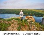 tourist on the rock. girl... | Shutterstock . vector #1290945058